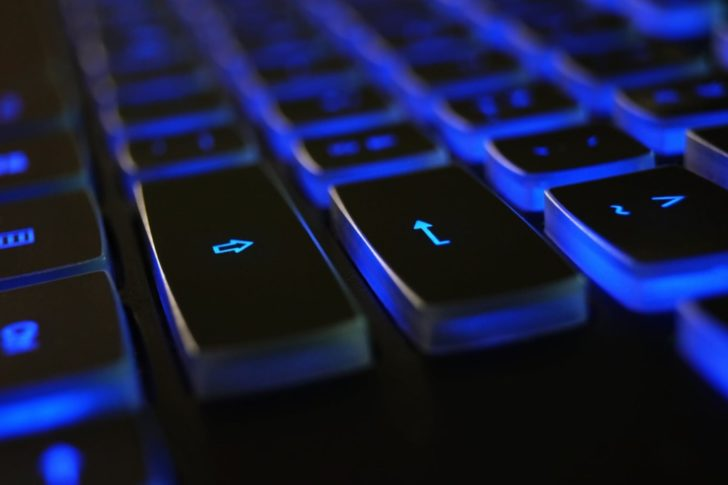 closeup photo of black and blue keyboard